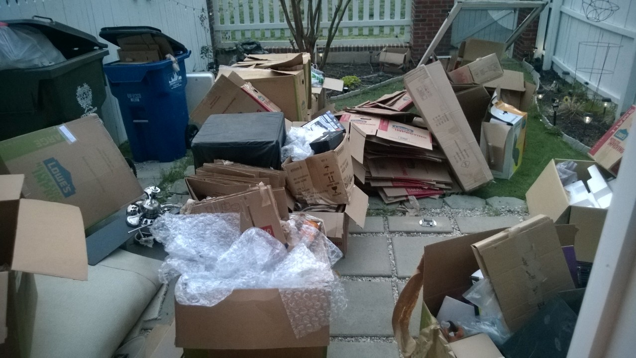 The start of the broken down boxes and trash in our back yard