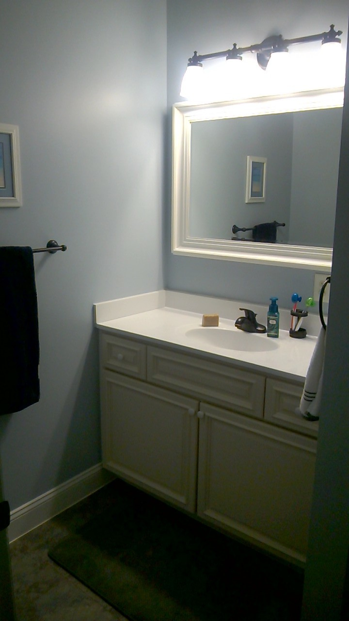 Full-width vanity with the mirror and lights that the Billingsley's helped with